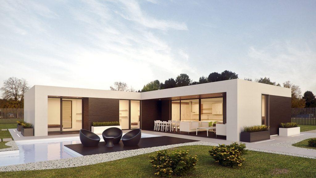 Maison design blanche avec jardin et piscine